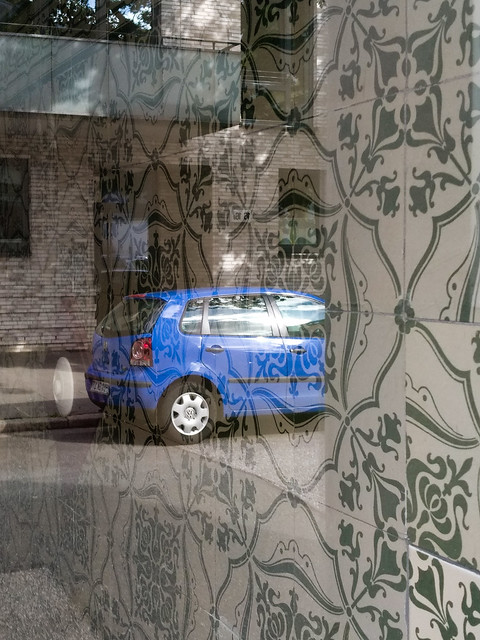 Tiles, blue car and a light switch