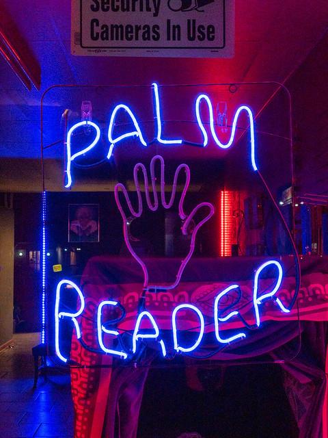 Neon palm reader