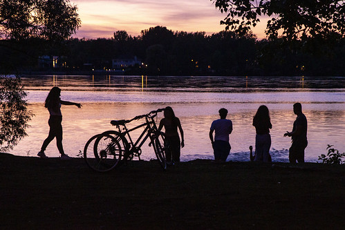 riverside water sunset silhouette friends bicycles trees river