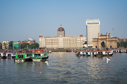 maharashtra arch colonial bombay monument city tourist boats destination structure sea attraction touristic india mumbai architecture gate skyline downtown ferries landscape old people port harbor cityscape ancient landmark town sky luxury exterior famous urban building palace travel tower british indian heritage gatewayofindia historic tourism culture tajhotel