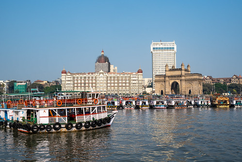 maharashtra arch historic bombay monument city tourist boats destination structure sea attraction touristic india mumbai architecture gate skyline downtown ferries building old people port harbor cityscape ancient landmark town gatewayofindia luxury famous indian urban sky palace travel tower british colonial heritage landscape exterior tourism culture tajhotel