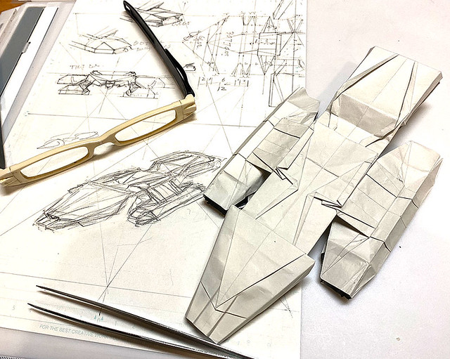 I am drafting the last page of the diagram of Battlestar Galactica origami and test-folding retouched one.