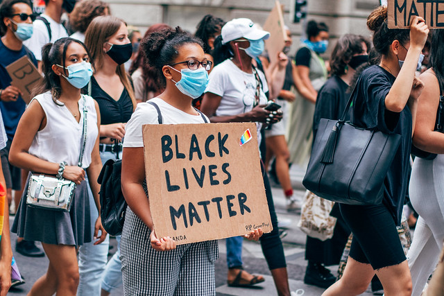 Black Lives Matter movement in Austria, a black woman is holding a sign with the message Black Lives Matter