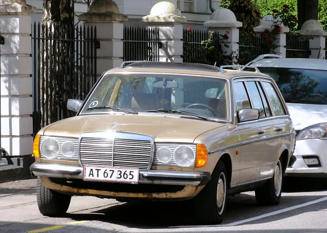 rusting 1982 Mercedes 230TE AT67365 still on the roads of Denmark
