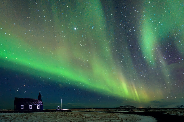 Northern Lights over famous Black church at Budir on the Snæfellsnes peninsula, Iceland