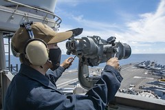 Seaman Alexander Chitty stands forward lookout watch on the signal bridge of USS Ronald Reagan (CVN 76) in the South China Sea, July 16. (U.S. Navy/MC3 Quinton A. Lee)