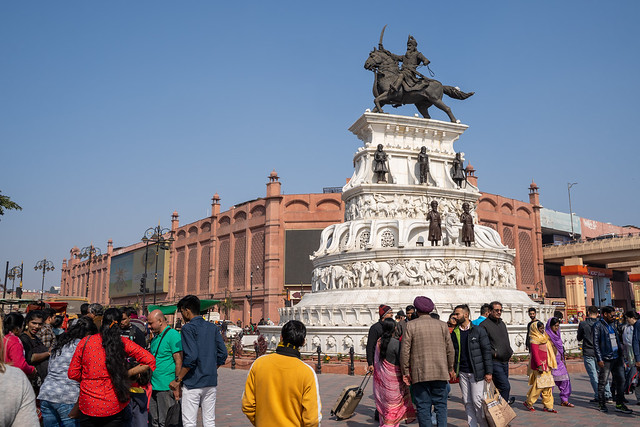 Amritsar India - Febuary 8, 2020: Crowds around the sculpture of Maharaja Ranjit Singh who was the leader of the Sikh religon