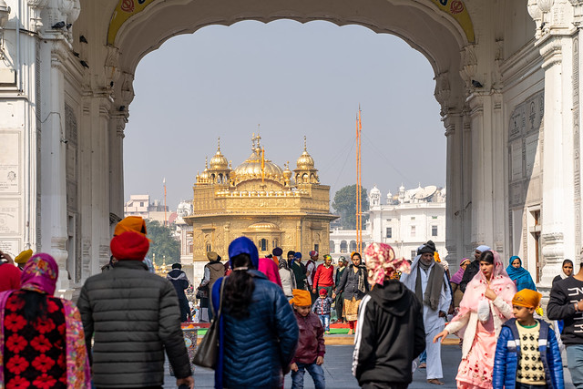 Amritsar India - Febuary 8, 2020: Sikh Golden Temple (sri harmandir sahib), with crowds of people paying respects and praying