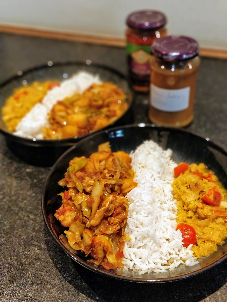 Cabbage & potato curry, rice and dhal in bowls