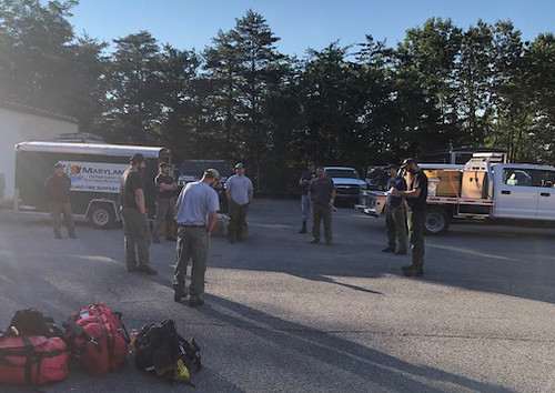 Photo of wildland firefighters gathering equipment at Green Ridge Fire Station