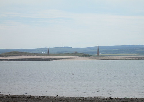 Obelisks and Lighthouse from Lindisfarne