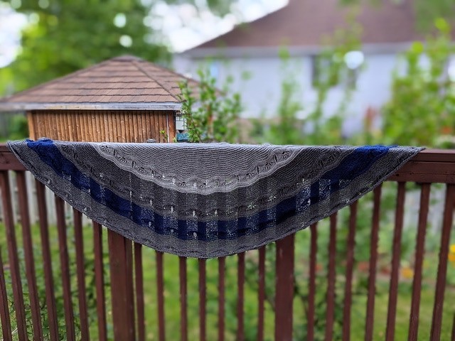 Linda (lmcnorton) knit her sister Joji's Odyssey Shawl but wanted it bigger! Linda undid her bind off and added a fourth section by repeating section 3. See her Ravelry notes for details. Yarn is Berroco Ultra Alpaca Light.
