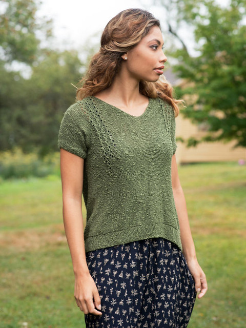 Breakwater Tee by Amy Christoffers is an elegant short sleeved pullover knit in reverse stockinette with eyelet columns at the shoulders. Knit using Berroco Quinoa.