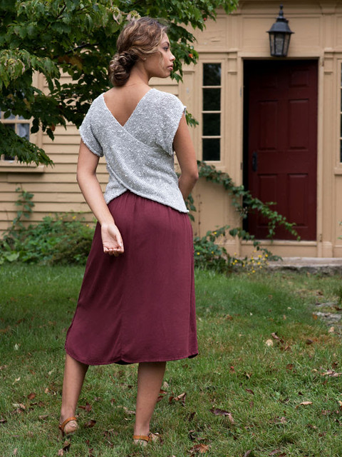 Davit Tee by Amy Palmer has a simple front while the back is two pieces that are crossed for an elegant wrap effect. Knit using Berroco Quinoa.