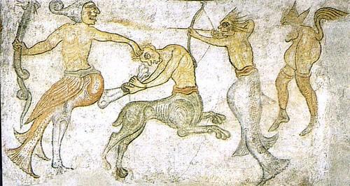 I-MOSTRI-DEL-MEDIOEVO-Combattimento-di-figure-mostruose-chiesa-di-San-Jacopo-Termeno-BZ-Public-Domain-via-Wikipedia-Commons
