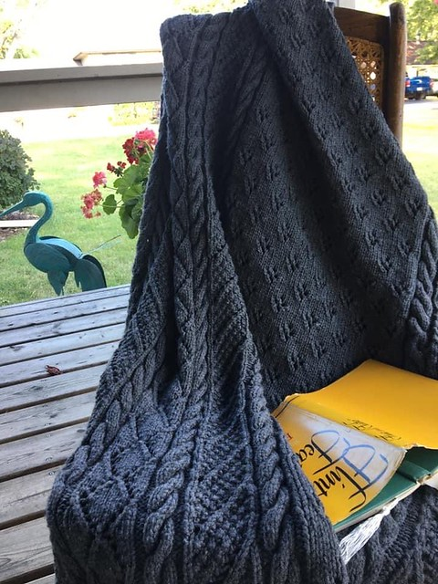 Liz (@su11ysmom) knit this cozy blanket for a future fundraiser raffle. Pattern is Caron Lace Panel Throw by Yarnspirations.