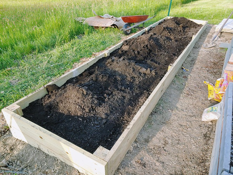 L12: Alternating topsoil, composts, earthworm castings, rasied bed soils, azomite, oyster shells, shredded leavesetc. One type at a time, mixed into under-layers with a garden rake!