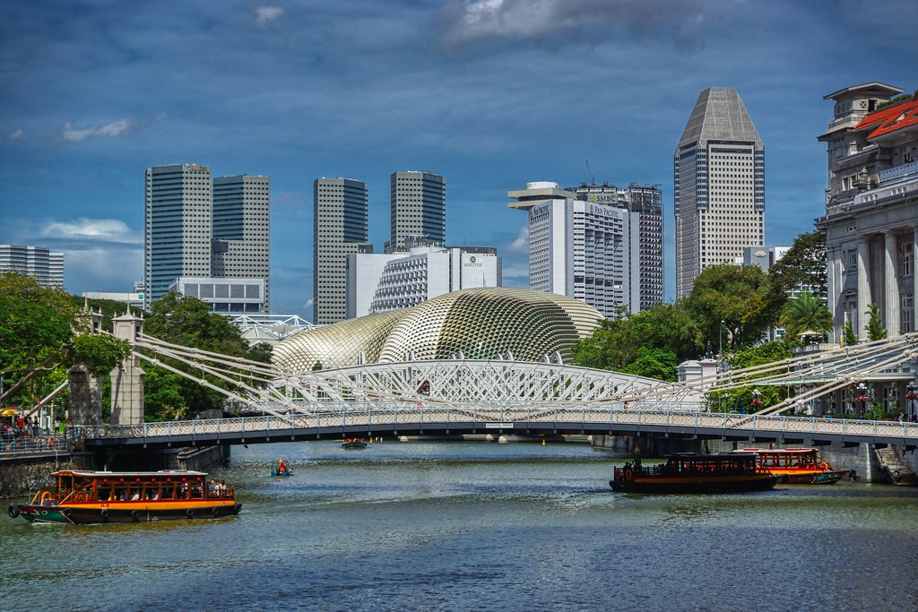 Singapore river with tourist bum boats, Cavenagh bridge and Esplanade Theaters by the Bay