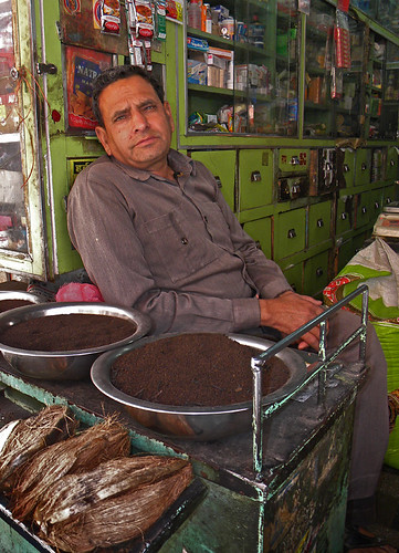 A shopkeeper in a tea shop in Udaipur, India