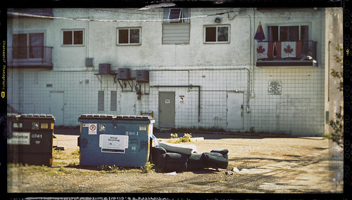film fake alberta alley edmonton nice ugly sony 85mm canada kanada urban living apartment stonyplain vanveenjf yunk trash garbage city town rundown poverty riches blue bins explored explore grimy dirty refuse department sanitation a7ll