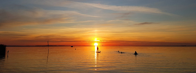 - stand up paddle boarding in the sunset -