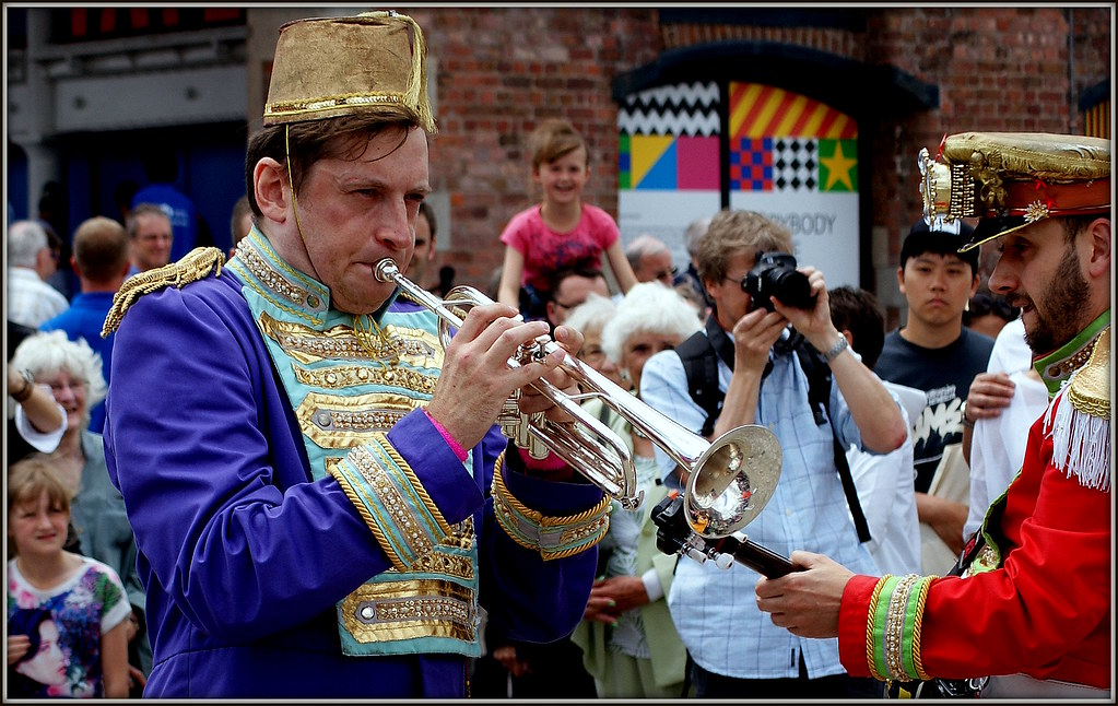 Blowing his own trumpet.