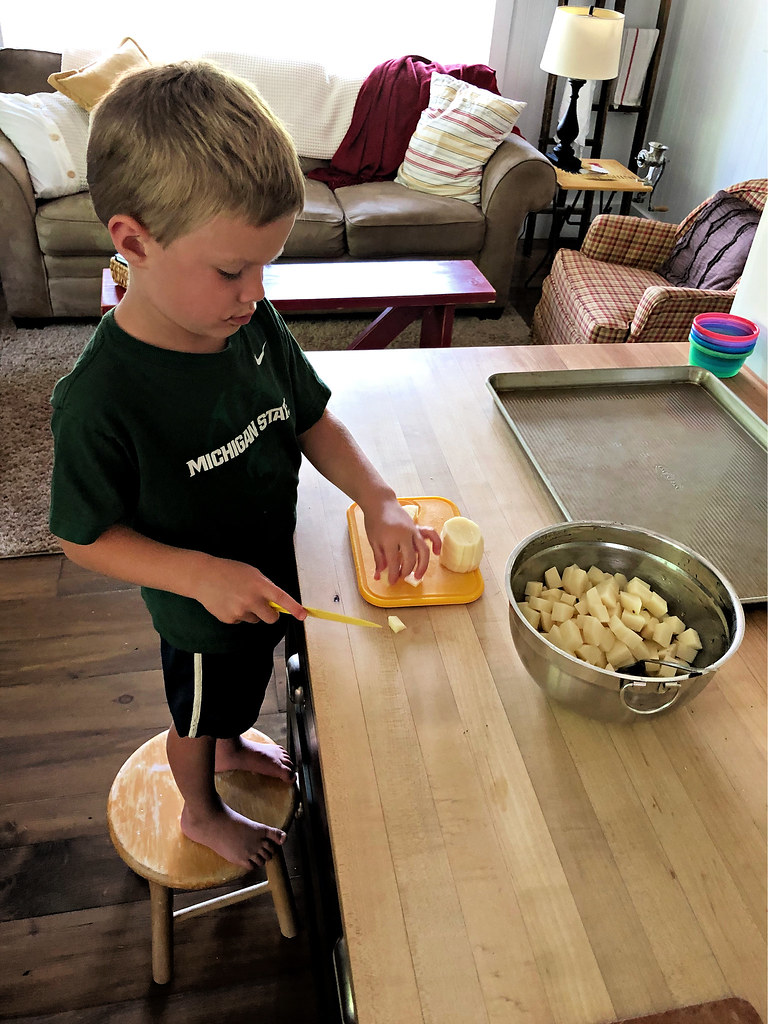 james chopping potatoes