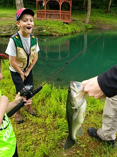 Photo of boy posing with largemouth bass