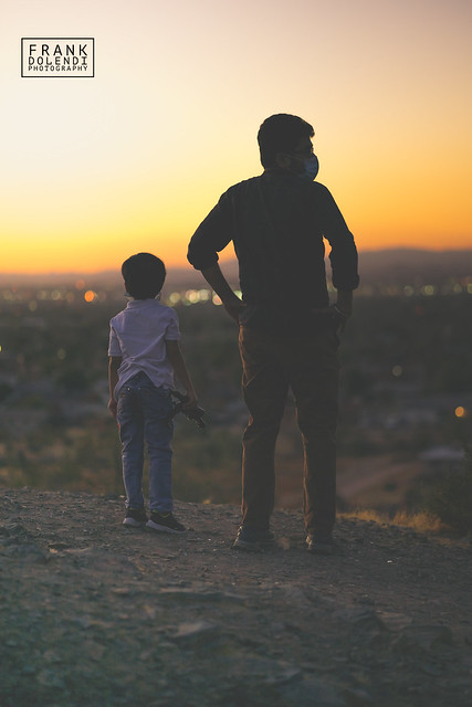 Father and son watching sunset from South Mountain Park in Phoenix, Arizona.