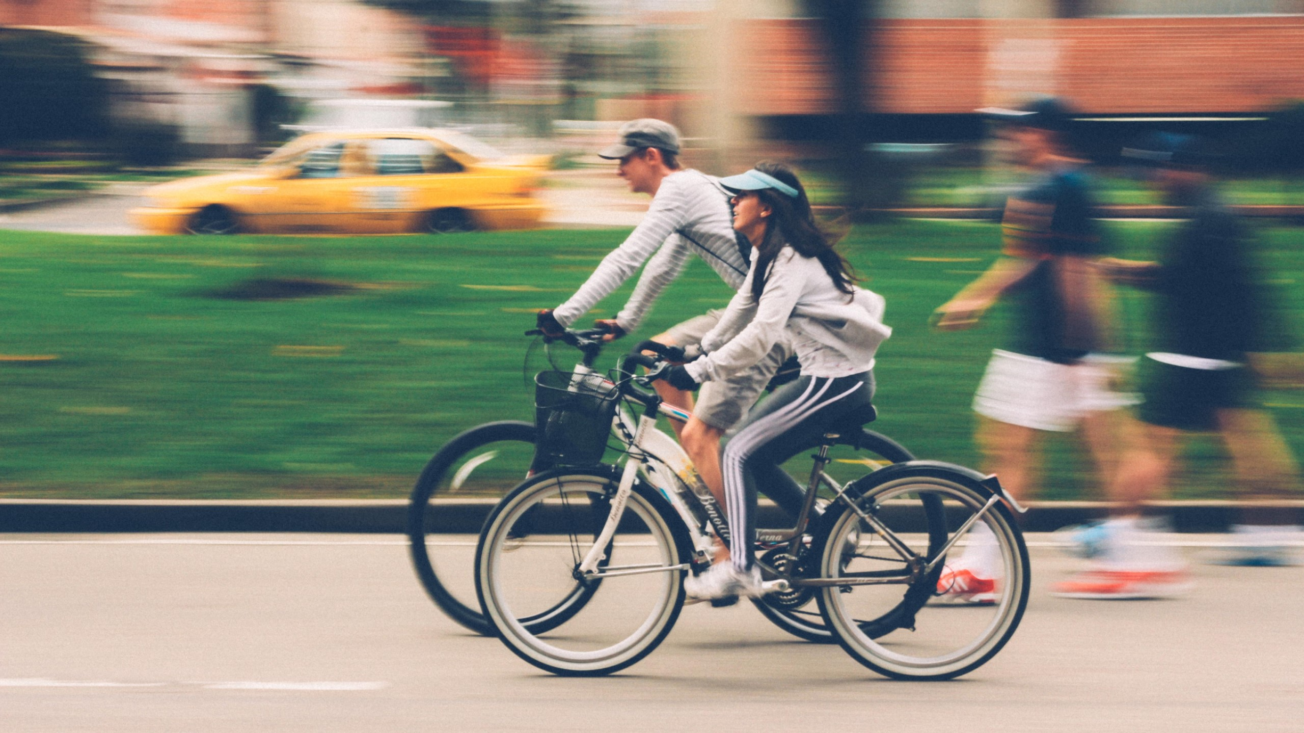 Photo of a man and a woman on bicycles