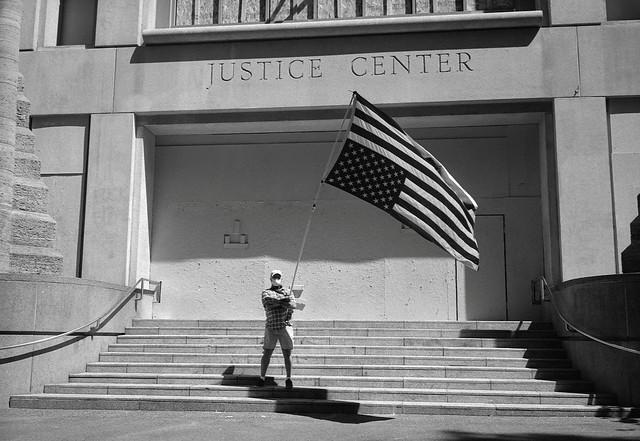 Man with Flag, Justice Center, Portland