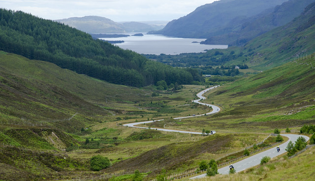 Looking down to Loch Maree with Bob and Ferg riding up the road.