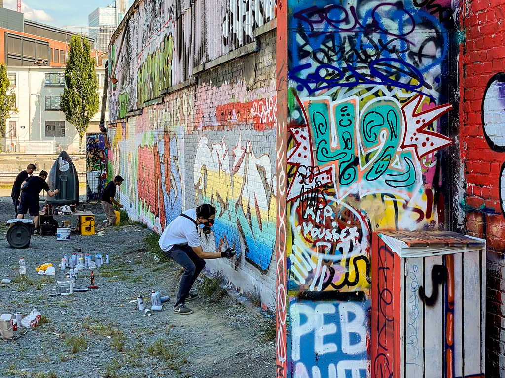 Street graffiti artists at work