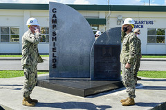 Cmdr. Jonathan Nieman, left, commanding officer of NMCB-3, receives authority of Camp Shields from Cmdr. Ryan Carey, NMCB-5 commanding officer, during a ceremony in Okinawa, July 20. (U.S. Navy/MC2 Michael Lopez)