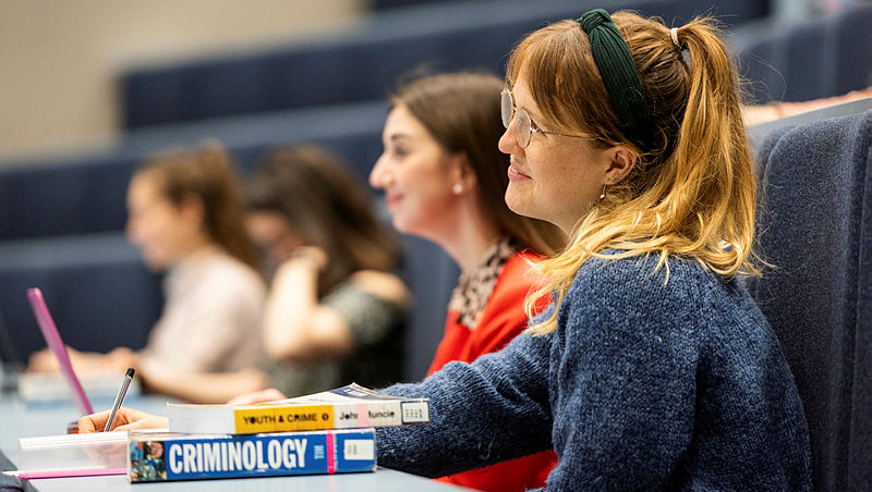 A criminology student in a lecture hall.