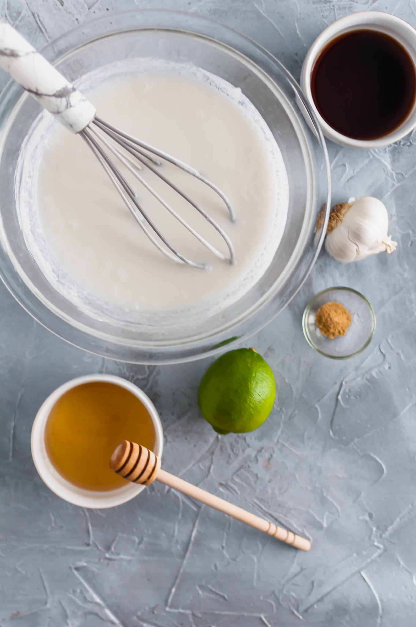 Ingredients needed for the recipe - unsweetened coconut milk, honey, lime, ground ginger, garlic and soy sauce.