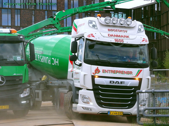 DAF XF CJ44033 kicking up dust is 2nd of 5 articulated concrete mixers shuttling on this foundations pouring job today