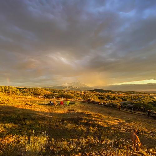 carbondale colorado mountsopris dog evening mountains stormclouds sunset