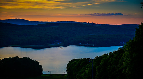 sunset over alpine lake terra alta wv terraalta westvirginia unitedstatesofamerica wva sun orange yellow dusk water hulls pond mountain hill range mountains hillside paysage landscape vista