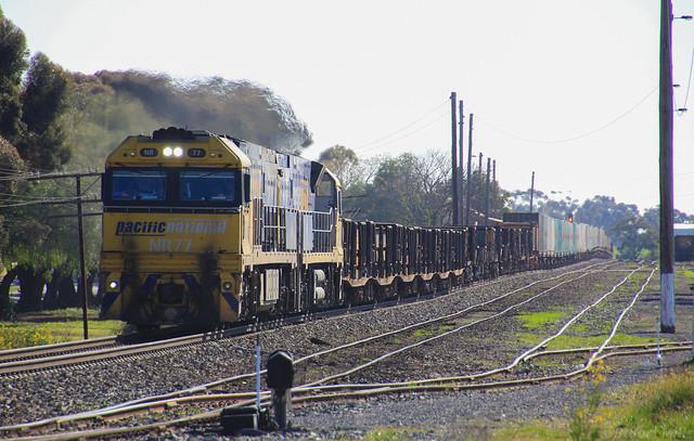 NR77 and NR57 lead a long PM4 steel service through Murtoa yard