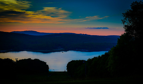 sunset over alpine lake terra alta wv terraalta westvirginia unitedstatesofamerica wva sun orange yellow dusk water hulls pond mountain hill range mountains hillside paysage landscape vista pano panorama panoramic