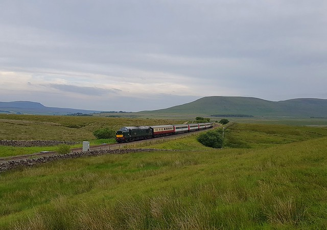 Loco D6817 on the rear of the 17.58 working to Skipton from Appleby, as the train approaches Ribblehead Viaduct. Loco 47593 'Galloway Princess' leads. 24 07 2020