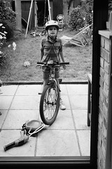 Wilfie getting out the bicycle