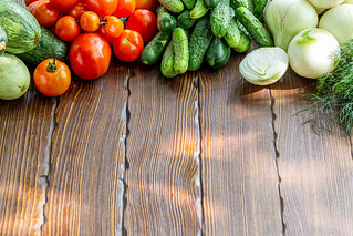 Organic raw vegetables on wooden background | by wuestenigel