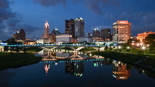 skyline columbus ohio downtown urban city blue hour evening twilight nightfall sunset main street bridge rich st scioto mile river riverfront water reflection panorama night lights dark sky clouds building architecture long exposure nikon z50 z 50 mirrorless nikkor 1650mm multicolored colors colorful