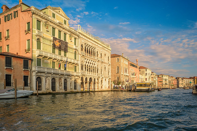 Majestic palaces overlooking Grand Canal at sunset