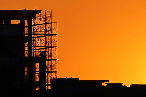 janbuchholtz silhouette sunset orange scaffolding buildings construction building project city cancel delay