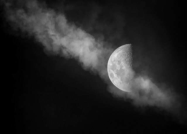 Half moon with clouds in Monochrome