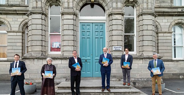 David Meehan, Rev Prof Anne Lodge, Martin Leavey, Prof Brian MacCraith, Dr Joseph Rivera and Dr Jonathan Cherry with the new book on DCU.
