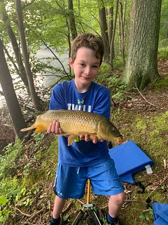 Photo of boy holding a carp